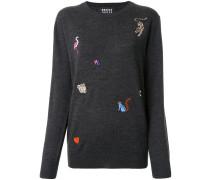 Pullover mit aufgestickten Tieren