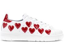 Sneakers mit Herz-Applikationen