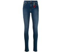 Skinny-Jeans mit Ringdetail