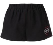 Shorts mit Glitzer-Print