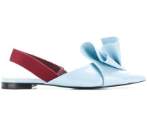 flared pointed toe mules