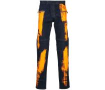Jeans in Farbklecks-Optik