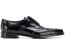Glänzende Derby-Schuhe