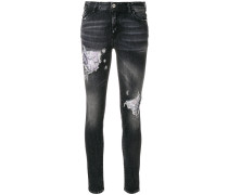 distressed floral inlay skinny jeans