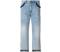Cropped-Jeans mit Pompons