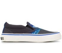 wing print slip-on sneakers