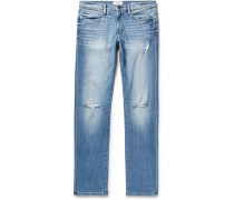L'homme Slim-fit Distressed Stretch-denim Jeans