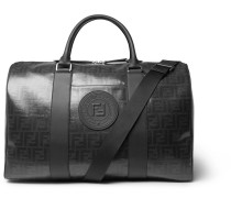 Leather-trimmed Logo-print Coated-canvas Holdall - Black