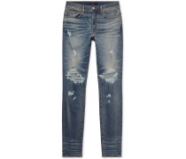 Thrasher Skinny-fit Distressed Stretch-denim Jeans