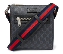 Leather-Trimmed Monogrammed Coated-Canvas Messenger Bag
