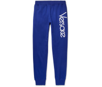 Tapered Logo-embroidered Loopback Cotton-jersey Sweatpants - Blue