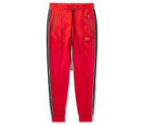 Slim-fit Tapered Leather-trimmed Tech-jersey Sweatpants - Red