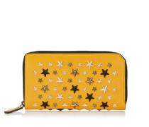 Carnaby Reisebrieftasche aus senffarbenem Leder mit metallischen Sternen