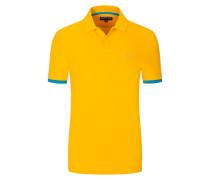 Piqué-Poloshirt, mit Kontrastbündchen in Orange