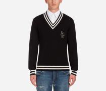 Pullover aus Baumwolle mit Zöpfen und V-Ausschnitt