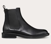 Valentino Garavani Uomo Chelsea Boots aus glänzendem Kalbsleder