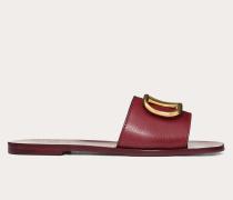 Valentino Garavani Slider-sandalen aus gekörntem Rindsleder mit Vlogo-accessoire