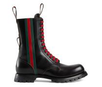 Stiefel aus schwarzem Leder mit Web
