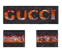 Gucci Stirnband und Handgelenkbänder