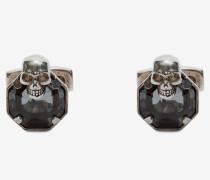 Manschettenknöpfe mit Stein und Skull