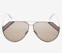 Sonnenbrille mit Schmucksteinchen und geschliffenen Gläsern