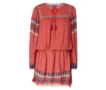 Kleid mit ornamentalem Muster und Zierquasten