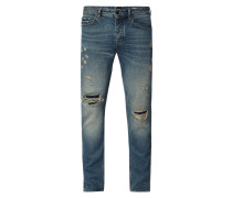 Tapered Fit Jeans im Destroyed & Repaired Look