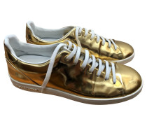 Second Hand  Sneakers aus Lackleder in Gold