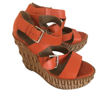 Second Hand  Sandalen aus Leder in Orange