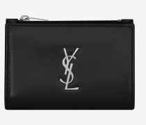 Monogram fragment clutch in shiny leather