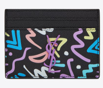 MONOGRAM card case in grain de poudre embossed leather with a graphic print