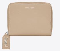 kompaktes rive gauche portemonnaie aus puderrosa narbenleder mit reißverschluss