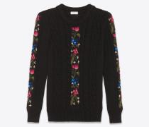 Bestickter Pullover in schwarzem Zopfmusterstrick