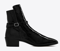 CLEMENTI buckle boots in patent leather