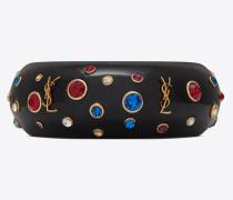 EIGHTIES Armreif aus schwarzem Kunstharz mit blauen, roten und weißen Kristallen