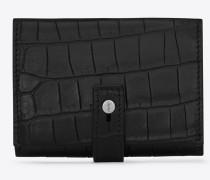 Kleines Sac de Jour Portemonnaie aus schwarzem Leder mit Krokodillederprägung