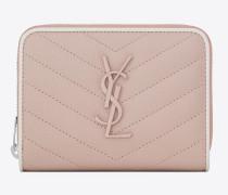 kompaktes portemonnaie aus pinkem und weißem leder mit steppnähten und struktur sowie reißverschluss