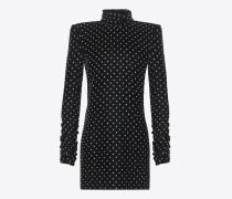 minikleid aus schwarzem samt mit rollkragen und quadratischer schulterpartie