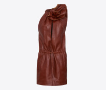 minikleid aus camelbraun glänzendem leder mit blume