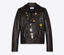Bikerjacke aus schwarzem Leder im 1980er-Look mit Pins und Ösen