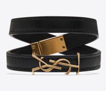 ysl doppeltes wickelarmband aus schwarzem leder und hellbronzefarbenem metall