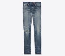 Skinny Jeans mit mittlerer Leibhöhe aus ausgewaschenem, zerrissenem Blue Denim