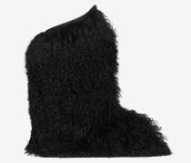 Fellstiefel aus schwarzem Langhaarfell und Leder