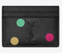 MONOGRAM card case in grain de poudre embossed leather with a confetti print