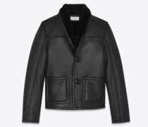 Jacke aus schwarzem Leder und Lammfell.