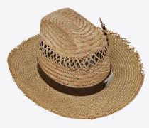 Cowboyhut aus Stroh mit Leder und Federn