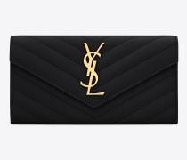 großes portemonnaie mit überschlag aus schwarzem matelassé-leder mit struktur