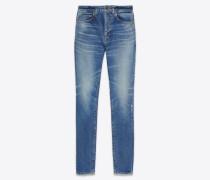 Skinny jeans in worn medium blue stretch denim