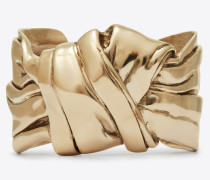 Armreif aus hellgoldfarbenem Metall mit drapierter Schleife
