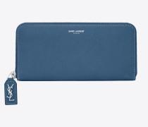 großes rive gauche portemonnaie aus denimblauem narbenleder mit reißverschluss